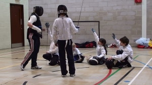 Helen Solly takes a group of young fencers